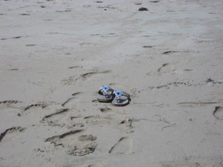 My sandals on the beach